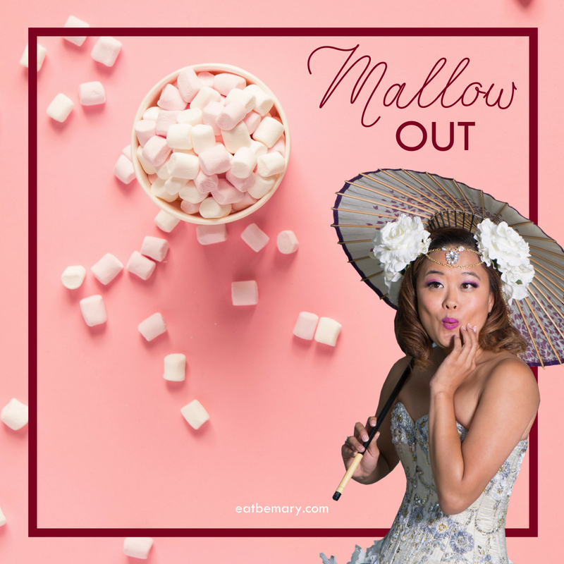 Mallow Out -Writing over a pink background with a cup full of marshmallows and a woman holding a parasol,